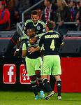 Nederland, Utrecht, 26 september  2012.Seizoen 2012-2013.KNVB Beker.FC Utrecht-Ajax.Ryan Babel (l.) van Ajax juicht nadat hij de 0-2 heeft gescoord. Tobias Sana (op Babel's rug) en Niklas Moisander (r.) van Ajax feliciteren hem.