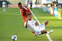 Carlo Costly (13)  of Honduras (HON) goes down after being fouled by Patrice Bernier (20)of Canada (CAN). Honduras (HON) defeated Canada (CAN) 1-0 during a quarterfinal match of the CONCACAF Gold Cup at Lincoln Financial Field in Philadelphia, PA, on July 18, 2009.