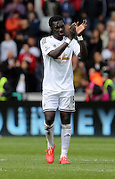 SWANSEA, WALES - MAY 17: Bafetimbi Gomis of Swansea thanks home supporters after the Premier League match between Swansea City and Manchester City at The Liberty Stadium on May 17, 2015 in Swansea, Wales. (photo by Athena Pictures/Getty Images)