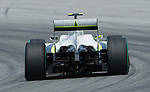04 Apr 2009, Kuala Lumpur, Malaysia --- Brawn GP Formula 1 Team driver Jenson Button of Great Britain steers his car, equipped with their new rear diffuser, during the secon practice session ahead the 2009 Fia Formula One Malasyan Grand Prix at the Sepang circuit near Kuala Lumpur. Photo by Victor Fraile --- Image by © Victor Fraile / The Power of Sport Images