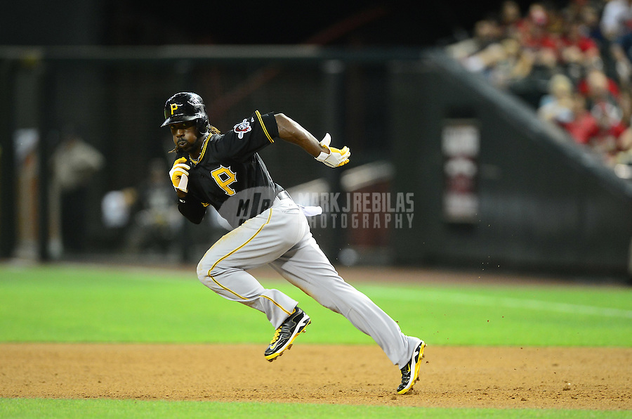 Apr. 17, 2012; Phoenix, AZ, USA; Pittsburgh Pirates outfielder (22) Andrew McCutchen steals second base against the Arizona Diamondbacks at Chase Field. Mandatory Credit: Mark J. Rebilas-