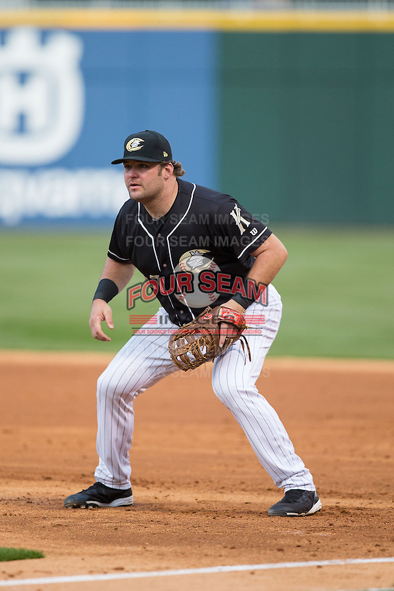 Charlotte Knights first baseman Dan Black (27) on defense against the Toledo Mud Hens at BB&T BallPark on April 27, 2015 in Charlotte, North Carolina.  The Knights defeated the Mud Hens 7-6 in 10 innings.   (Brian Westerholt/Four Seam Images)