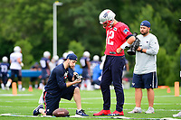 July 27, 2017:  A member of the coaching staff checks a glove for New England Patriots quarterback Tom Brady (12) at the New England Patriots training camp held on the practice field at Gillette Stadium, in Foxborough, Massachusetts. Eric Canha/CSM