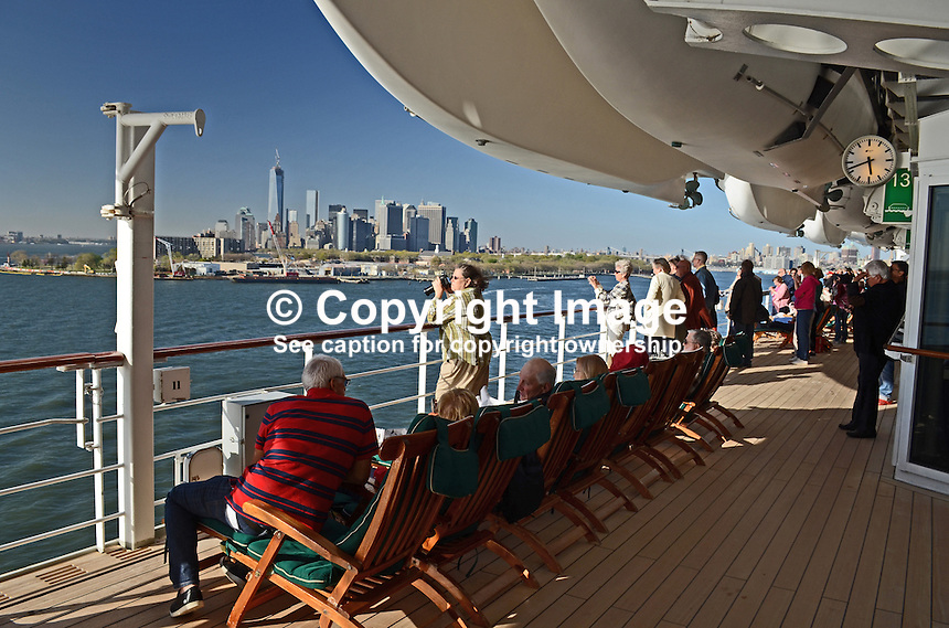 Passengers line the decks to have a farewell view of the Big Apple, New York, USA, as the Queen Mary 2 sets sail for Southampton, UK, 3rd May 2013, 201305042377<br /> <br /> Copyright Image from Victor Patterson, 54 Dorchester Park, Belfast, UK, BT9 6RJ<br /> <br /> Tel: +44 28 9066 1296<br /> Mob: +44 7802 353836<br /> Voicemail +44 20 8816 7153<br /> Skype: victorpattersonbelfast<br /> Email: victorpatterson@me.com<br /> Email: victorpatterson@ireland.com (back-up)<br /> <br /> IMPORTANT: If you wish to use this image or any other of my images please go to www.victorpatterson.com and click on the Terms &amp; Conditions. Then contact me by email or phone with the reference number(s) of the image(s) concerned.