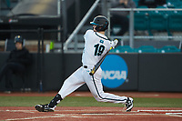 Fox Leum (19) of the Coastal Carolina Chanticleers follows through on his swing against the Illinois Fighting Illini at Springs Brooks Stadium on February 22, 2020 in Conway, South Carolina. The Fighting Illini defeated the Chanticleers 5-2. (Brian Westerholt/Four Seam Images)