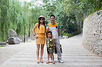 A family poses for a portrait in Changle Park in Xian, Shaanxi Province, China.