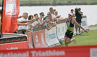 09 JUN 2007 - TREDEGAR, UK - Tim Don is congratulated by spectators as he wins the National Elite Mens Triathlon Championships which were held as part of the second round of the Corus Elite Triathlon Series. (PHOTO (C) NIGEL FARROW)