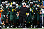 09/17/11-- Oregon head coach Chip Kelly leads the Ducks into Autzen Stadium to play  Missouri State...Photo by Jaime Valdez. ..............................................