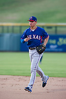 AZL Rangers shortstop Chris Seise (8) jogs off the field between innings of the game against the AZL Cubs on July 24, 2017 at Sloan Park in Mesa, Arizona. AZL Cubs defeated the AZL Rangers 2-1. (Zachary Lucy/Four Seam Images)