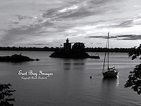 A sailboat moored near the Pomham Rocks Lighthouse.