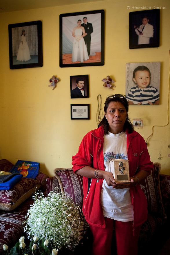 "April 26, 2009 - Mexico City, Mexico - Oscar Corona Perez' s grandmother with the ashes of her grandson in her apartment in Mexico City. Oscar Corona Perez, 5 years old, died yesterday after 8 days of treatment at ""La Raza"" national medical center. The family was told on Friday that the medication and operations that had been done had no effect as Oscar had a new illness with no treatment. The next morning he died at 11:00 AM of pneumonia caused by swine Flu. The death toll has risen to over 80 people in Mexico City, and 929 people have the disease. All dead bodies with the influenza must be cremated. Photo credit: Benedicte Desrus / Sipa Press"