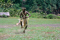 Man from the John Frum Cargo Cult Movement dancing in traditional dress, Sulphur Bay Village, Ipekel Ipeukel, Tanna Island, Vanuatu.