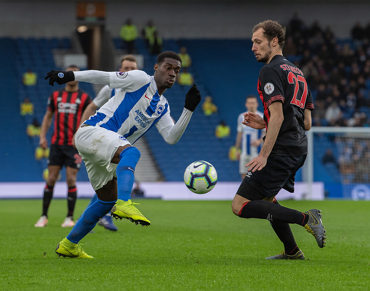 Brighton & Hove Albion's Yves Bissouma (left) under pressure from Huddersfield Town's Jon Gorenc Stankovic (right) <br /> <br /> Photographer David Horton/CameraSport<br /> <br /> The Premier League - Brighton and Hove Albion v Huddersfield Town - Saturday 2nd March 2019 - The Amex Stadium - Brighton<br /> <br /> World Copyright © 2019 CameraSport. All rights reserved. 43 Linden Ave. Countesthorpe. Leicester. England. LE8 5PG - Tel: +44 (0) 116 277 4147 - admin@camerasport.com - www.camerasport.com