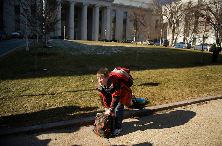 UNITED STATES - JANUARY 13:  Adrian Huizenga, 11, son of Rep. Bill Huizenga, R-Mich., arrives at the Rayburn horseshoe to board a bus that will bring Republican members of the House and their families to their annual retreat in Baltimore. (Photo By Tom Williams/Roll Call)
