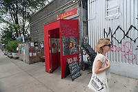Trendy Roberta's restaurant in the Bushwick neighborhood of Brooklyn in New York on Saturday, August 16, 2014. Roberta's was one of the first restaurants to set up shop in the neighborhood causing ti to become a destination. The neighborhood is undergoing gentrification changing from a rough and tumble mix of Hispanic and industrial to a haven for hipsters and a destination for tourists, forcing many of the long-time residents out because of rising rents. (© Richard B. Levine)