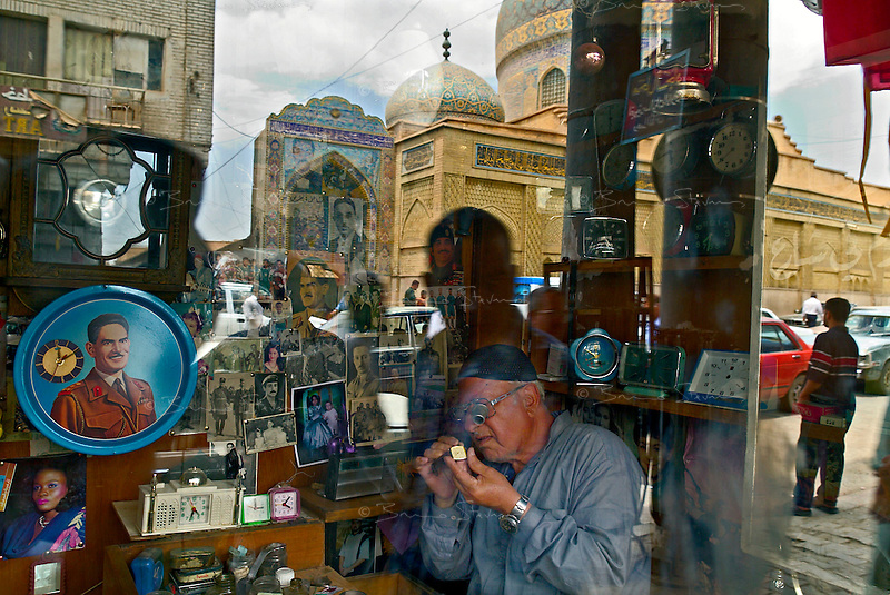 Baghdad, Iraq, June 4, 2003.The walls from the tiny shop of Abu Haidar the watchmaker in Rashid street are covered from Iraqi and Arab leaders from the past: Kassem, King Faycal, King Hussein, Nasser and many others.