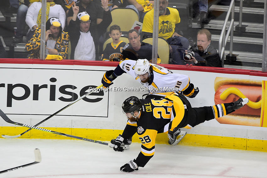 June 8, 2017: Pittsburgh Penguins defenseman Ian Cole (28) checks Nashville Predators left wing James Neal (18) during game five of the National Hockey League Stanley Cup Finals between the Nashville Predators  and the Pittsburgh Penguins, held at PPG Paints Arena, in Pittsburgh, PA. Eric Canha/CSM