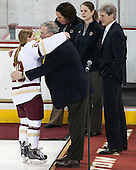 Kate Leary (BC - 28), Tom Peters (BC - Senior Associate AD), Courtney Kennedy (BC - Associate Head Coach), Katie King Crowley (BC - Head Coach), Brad Bates (BC - AD) -  The Boston College Eagles defeated the visiting Boston University Terriers 5-0 on BC's senior night on Thursday, February 19, 2015, at Kelley Rink in Conte Forum in Chestnut Hill, Massachusetts.