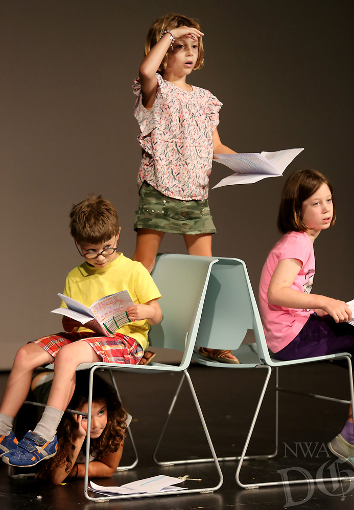 NWA Democrat-Gazette/DAVID GOTTSCHALK   Leyla Boelkins (center) rehearses her lines Thursday, July 6, 2017, with campers participating in the Readers Theatre with Page Darragh during The New School Summer Camp 2017 on the campus in Fayetteville. The school is offering 50 different camps for ages first through eighth grades. The camps are taught by New School teachers and professionals in the community. This week first through third grade students are participating in theatre,  Sporty Craft Camp and Minecraft Design and Engineering.