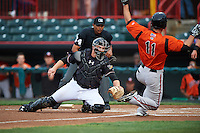 Erie SeaWolves catcher John Hicks (41) looks to tag Drew Dosch (11) sliding into home as umpire Erich Bacchus looks on during a game against the Bowie Baysox on May 12, 2016 at Jerry Uht Park in Erie, Pennsylvania.  Bowie defeated Erie 6-5.  (Mike Janes/Four Seam Images)