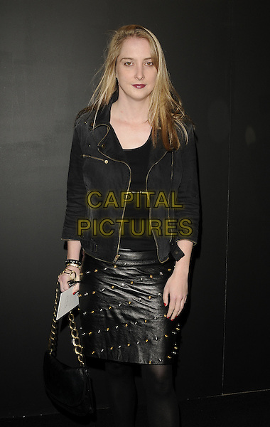 DAISY DE VILLENEUVE.The Pringle of Scotland show, London Fashion Week Day 4, Saatchi Gallery, London, England..September 21st, 2009.LFW half 3/4 length black leather skirt studs studded jacket suede tights bag purse.CAP/CAN.©Can Nguyen/Capital Pictures.