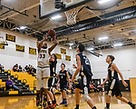WATERBURY, CT. 09 January 2020-010920BS214 - Kaynor Tech's Masai Johnson (33) goes up for a shot down low against Wolcott Tech's Mike Cappetto (20), as Wolcott Tech players, from left, Thad Kimberley (11), David Sidoti (21), and Jacob Fogarty (3) all look on, during a Boy Basketball game between Wolcott Tech and Kaynor Tech at Kaynor Tech in Waterbury on Thursday. Bill Shettle Republican-American