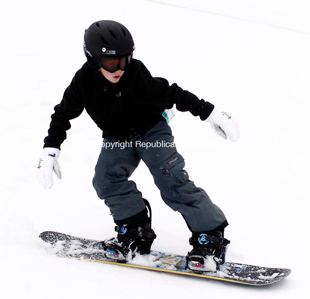 Woodbury, CT- 05 January 2015-010415CM04-  Adrian Csati, 9, of Fairfield snowboards down a hill at Woodbury Ski Area on Sunday.  Christopher Massa Republican-American