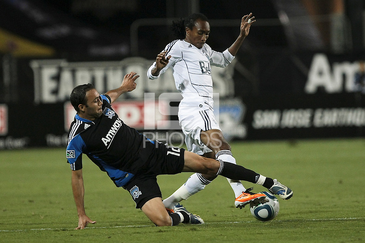 Ramiro Corrales (left) slide tackles Nizar Khalfan (16). The San Jose Earthquakes tied the Vancouver Whitecaps 2-2 at Buck Shaw Stadium in Santa Clara, California on July 20th, 2011.