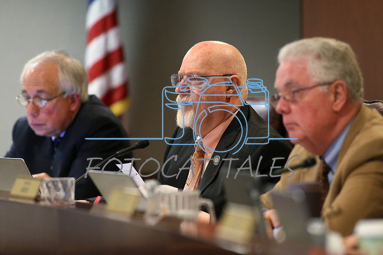 Nevada Assembly Republicans, from left, Pat Hickey, Randy Kirner and John Hambrick work in committee at the Legislative Building in Carson City, Nev., on Wednesday, April 22, 2015. <br /> Photo by Cathleen Allison