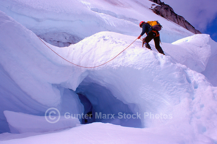 Hiker roped up for Safety while hiking in Snow on Coast Mountains, near Pemberton, BC, British Columbia, Canada