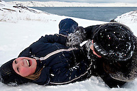 Two girls play in the snow in the town of Teriberka, a former prosperous fish-processing community in Russia's Arctic region. Teriberka's population shrunk from about 14,000, at its height, to just over a 1,000 after the fishing industry collapsed. However one of the world's largest known natural gas reserves, the Shtokman gas field, was discovered off its shores and promises to bring new life to the area. /Felix Features