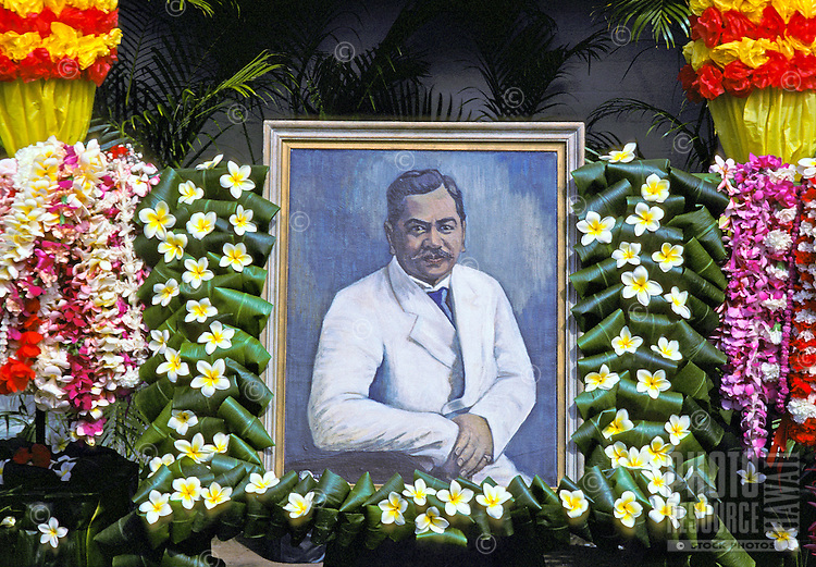 Colorful leis surrounding a Portrait of Prince Kuhio, a celebration of Prince Kuhio Day at Kuhio Elementary School