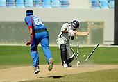 Afghanistan V UAE - World T20 Super Four stage qualifying cricket match in Dubai Sports City Cricket Stadium - Afghanistan bowler Hamid Hassan takes the wicket of UAE batsman Naeemuddin Aslam. The winners of this match qualify for the World T20 - Picture by Donald MacLeod 13.02.10