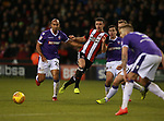 Enda Stevens of Sheffield Utd passes the ball through a crowd of Bolton players during the Championship match at Bramall Lane Stadium, Sheffield. Picture date 30th December 2017. Picture credit should read: Simon Bellis/Sportimage