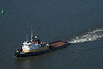 Aerial view of the Crowley Maritime Patriarch Tugboat sailing in the Delaware River
