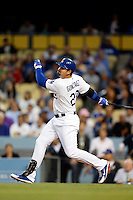 Adrian Gonzalez #23 of the Los Angeles Dodgers bats against the Colorado Rockies at Dodger Stadium on April 30, 2013 in Los Angeles, California. (Larry Goren/Four Seam Images)