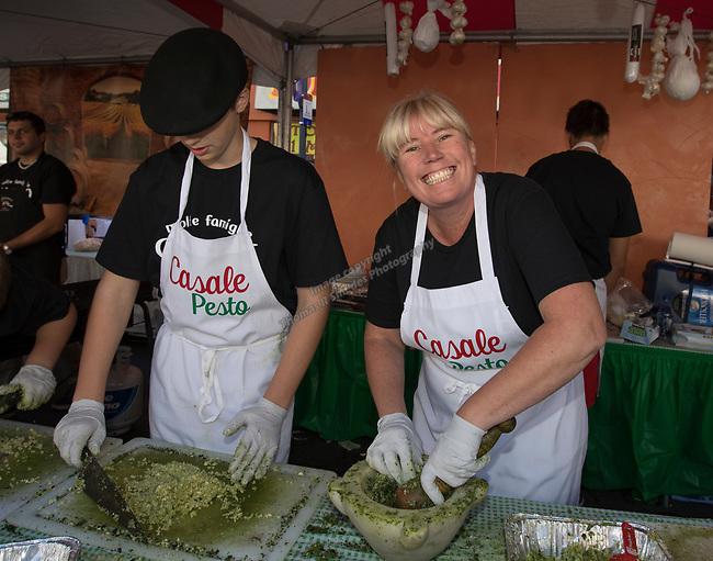 Rhonda Cerven making pesto sauce during the Italian Festival in downtown Reno on Saturday, Oct. 7, 2017.