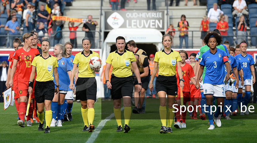 20180904 - LEUVEN , BELGIUM : both teams pictured arriving on the pitch with Belgian Aline Zeler , French Elodie Coppolo , French Florence Guillemin , Belgian Ella De Vries , French Manuela Nicolosi and Italian Sara Gama during the female soccer game between the Belgian Red Flames and Italy , the 8th and last game in the qualificaton for the World Championship qualification round in group 6 for France 2019, Tuesday 4 th September 2018 at OHL Stadion Den Dreef in Leuven , Belgium. PHOTO SPORTPIX.BE | DAVID CATRY