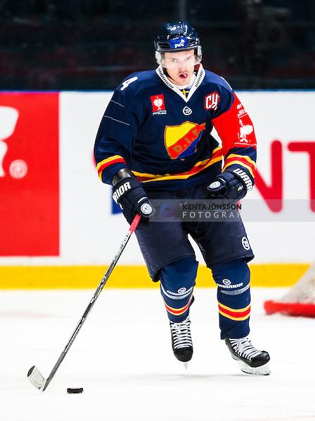 Stockholm 2014-09-05 Ishockey CHL Djurg&aring;rdens IF - Eisb&auml;ren Berlin :  <br /> Djurg&aring;rdens Marcus H&ouml;gstr&ouml;m i aktion <br /> (Foto: Kenta J&ouml;nsson) Nyckelord:  Djurg&aring;rden Hockey Hovet CHL Eisb&auml;ren Berlin portr&auml;tt portrait