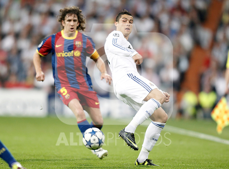 Real Madrid's Cristiano Ronaldo against Barcelona's Carles Puyol during Champions League match in Madrid. April 27, 2011. (ALTERPHOTOS/Alvaro Hernandez)