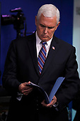 United States Vice President Mike Pence looks through a folder during a news conference at the White House in Washington D.C., U.S. on Monday, April 20, 2020. <br /> Credit: Tasos Katopodis / Pool via CNP
