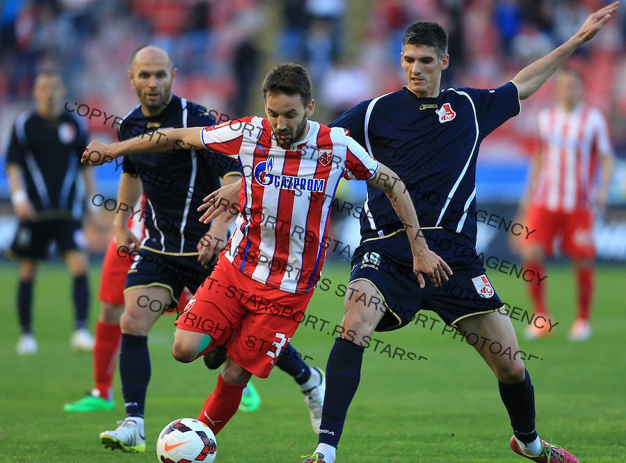Fudbal Jelen super league season 2013-2014<br /> Crvena Zvezda v Radnicki Nis<br /> Milos Ninkovic (L) and Milan Culum<br /> Beograd, 04.22.2014.<br /> foto: Srdjan Stevanovic/Starsportphoto&copy;