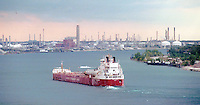 A Canada Steamship Lines Great lakes freighter sails south on the St. Clair passing Sarnia, Port Huron and the Chemical Valley.