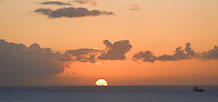 Sunset off Waikiki.  We watched the sun drop swiftly out of the sky from our lanai, or balcony.  Canon EOS 5D, 70-200 f/2.8L lens