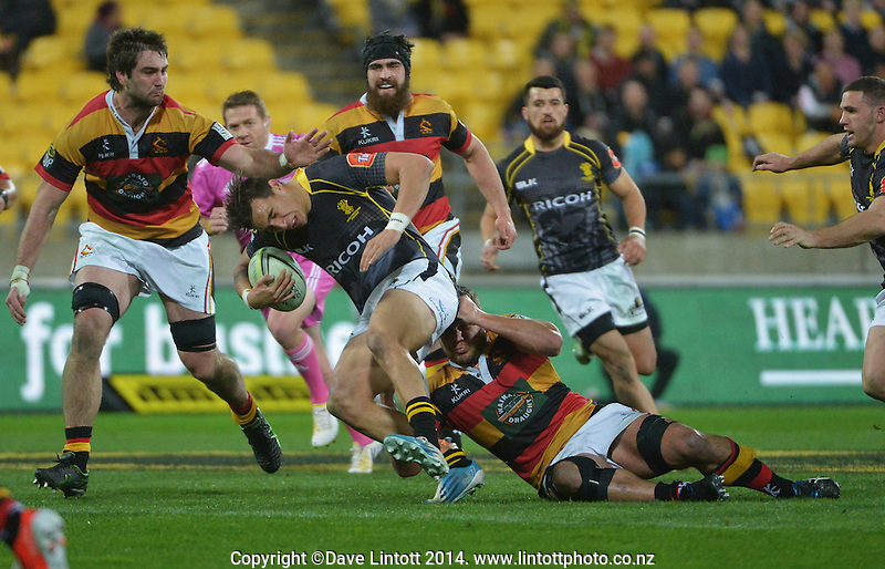 Ambrose Curtis is brought down during the ITM Cup rugby union match between Wellington Lions and Waikato at Westpac Stadium, Wellington, New Zealand on Saturday, 16 August 2014. Photo: Dave Lintott / lintottphoto.co.nz