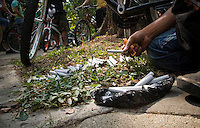"""Colombian people take part during the First """"World Bicicleteada Cannavica""""  as they smoke while working out to promote the legalization of medical Marijuana in Medellin, Colombia, on October 6, 2012. Photo by Fredy Amariles Garcia /VIEWpress."""