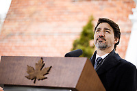 PrimeMinister Trudeau speaks with media outside of Rideau Cottage during his ongoing self-isolation. March 19, 2020.