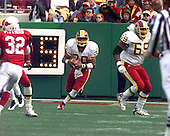 Washington Redskins running back / kick returner Brian Mitchell (30) carries the ball during the game against the Arizona Cardinals at Jack Kent Cooke Stadium in Raljon, Maryland on November 22, 1998.  The Cardinals won the game 45 - 42.<br /> Credit: Arnie Sachs / CNP