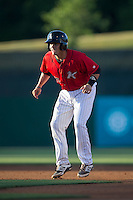 Brett Austin (20) of the Kannapolis Intimidators takes his lead off of first base against the Hickory Crawdads at CMC-Northeast Stadium on May 22, 2015 in Kannapolis, North Carolina.  The Intimidators defeated the Crawdads 4-3.  (Brian Westerholt/Four Seam Images)