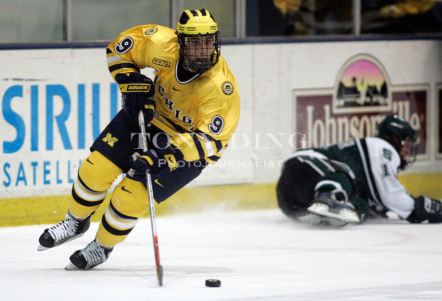 4 November 2006: Michigan forward Andrew Cogliano (9) skates with the puck during a CCHA conference ice hockey game between Michigan and in-state rival Michigan State, at Yost Ice Arena in Ann Arbor, MI. Michigan won the game 6-2.
